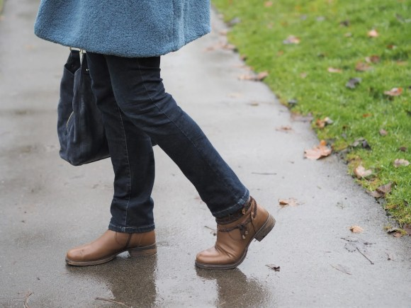 straight jeans and brown biker boots