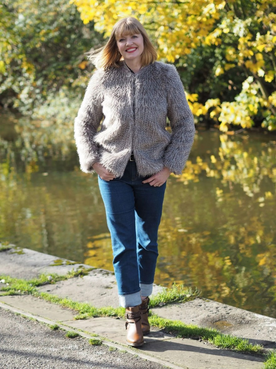 faux fur jacket with girlfriend jeans and biker boots
