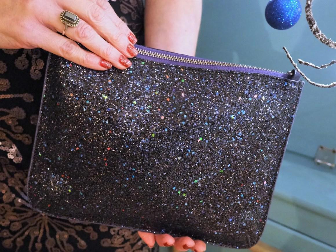 multicoloured glitter clutch bag