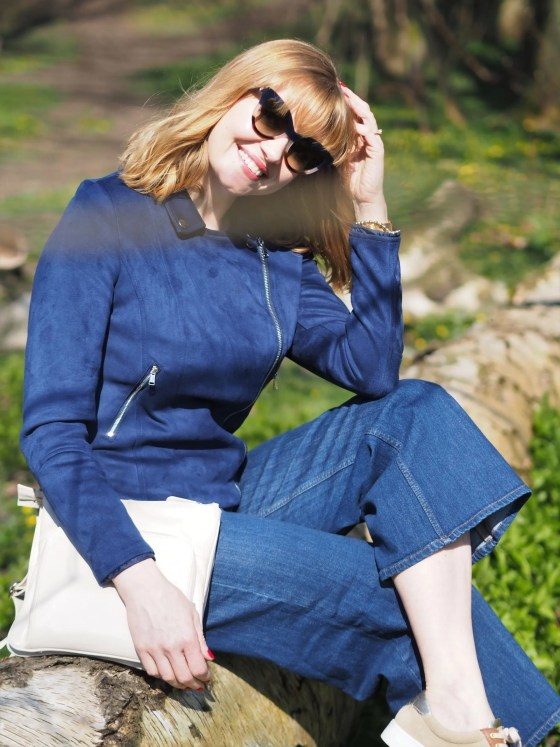 woman in navy outfit wearing sunglasses