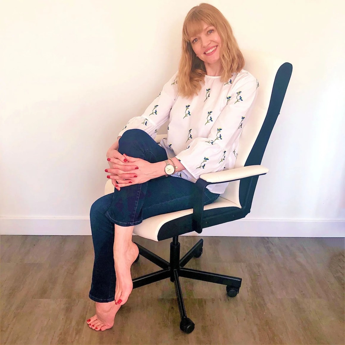 woman sitting in office chair