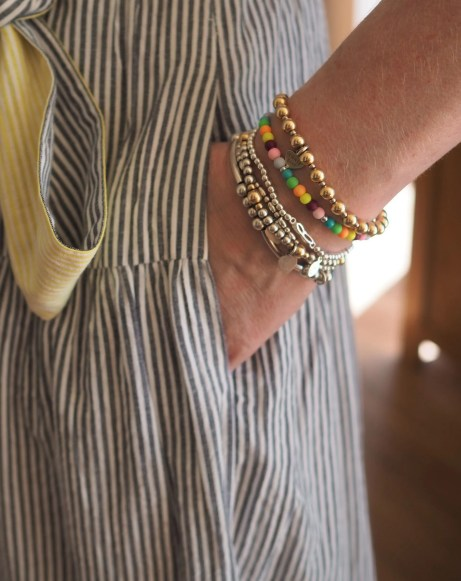 mix of silver and rainbow bracelets