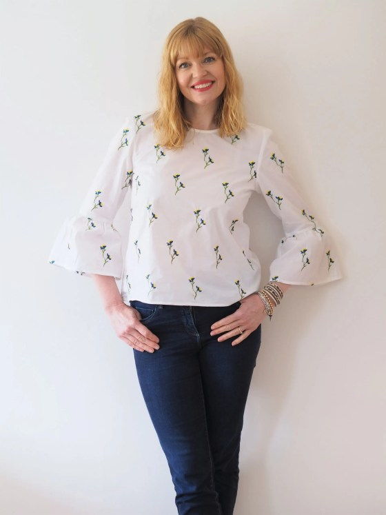woman wearing white embroidered blouse