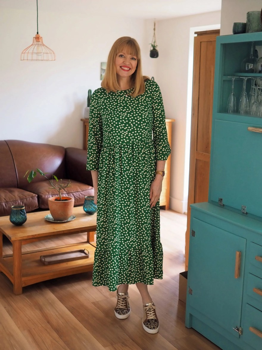 green polka dot dress with leopard print trainers