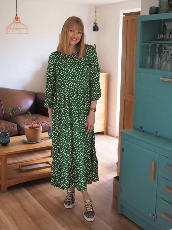 green polka dot dress with leopard print trainers