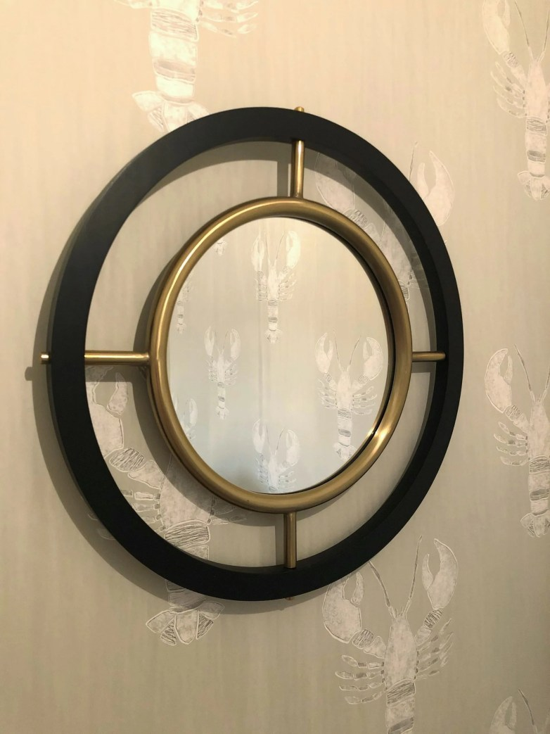 black and gold circular mirror