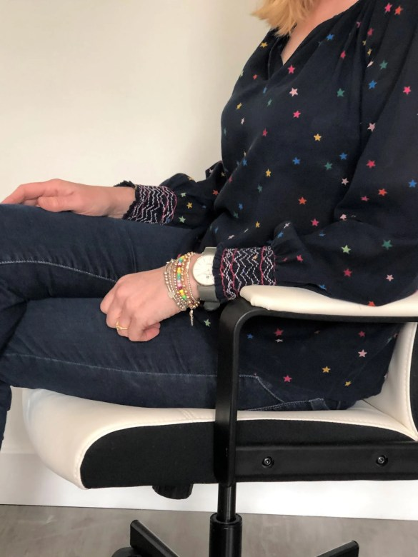 woman wearing star print top and jeans