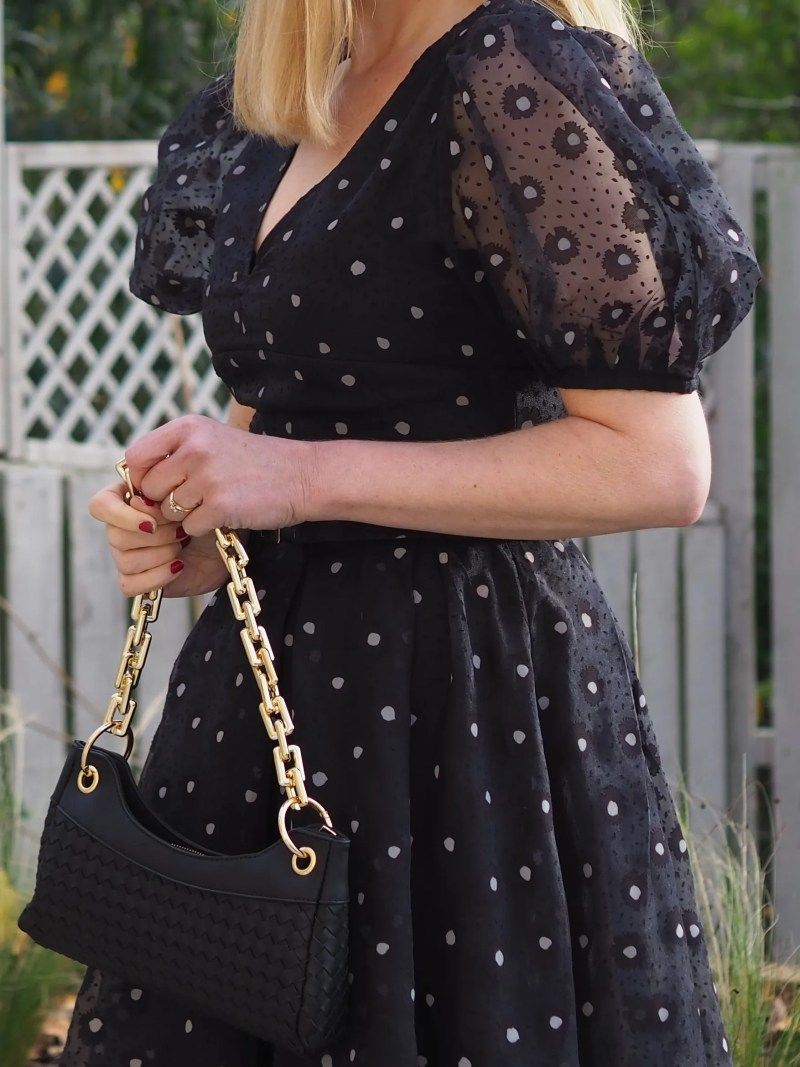 black woven bag with chunky gold chain strap