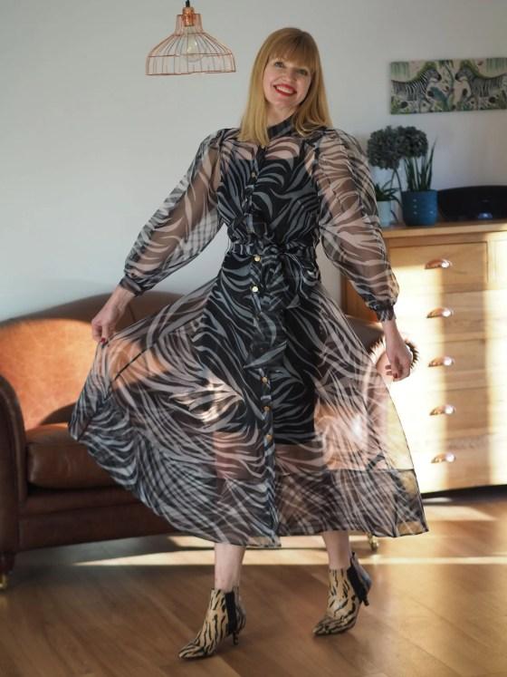 zebra print dress with tiger print boots