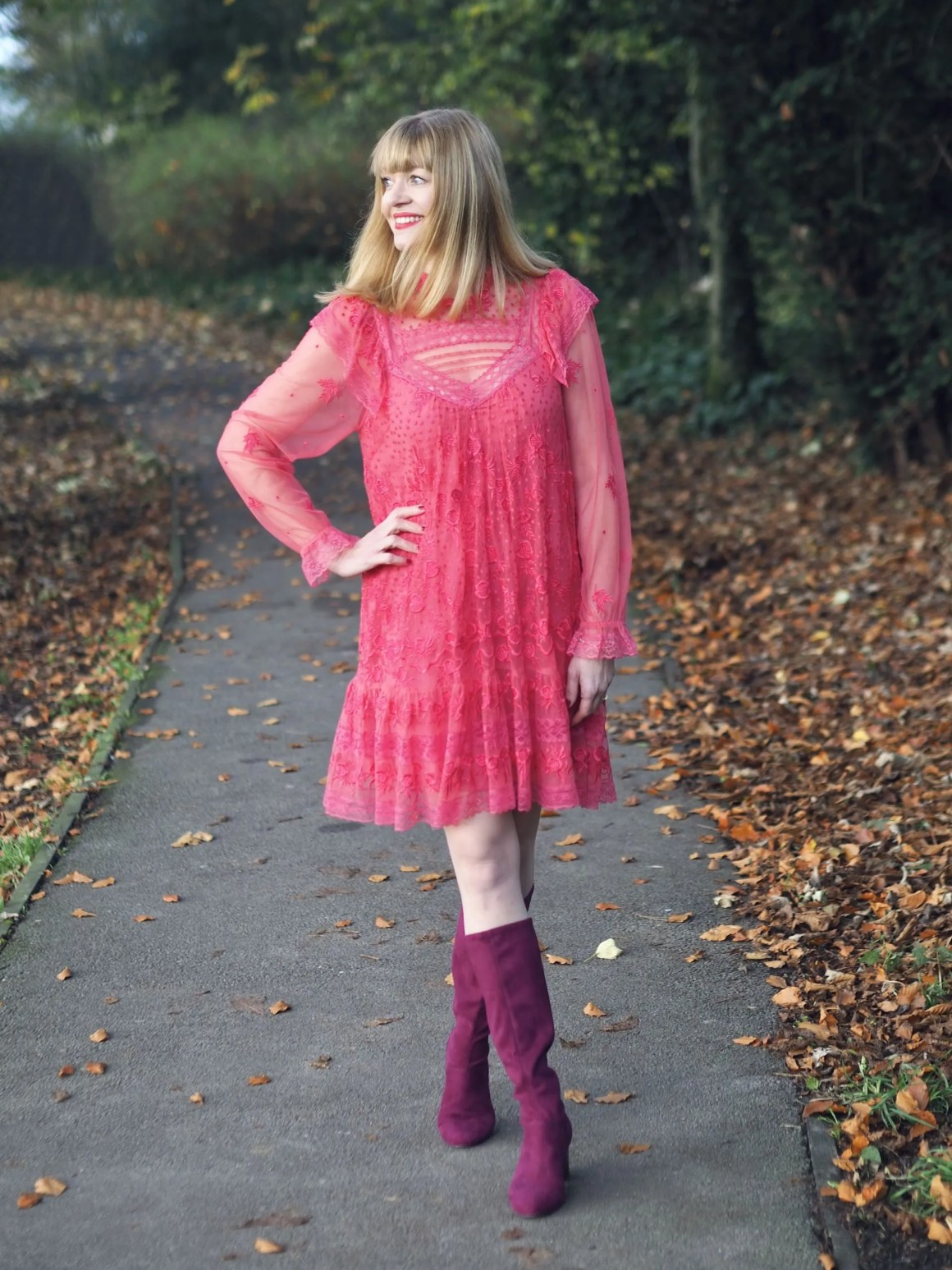 Knee length coral dress with burgundy knee high boots