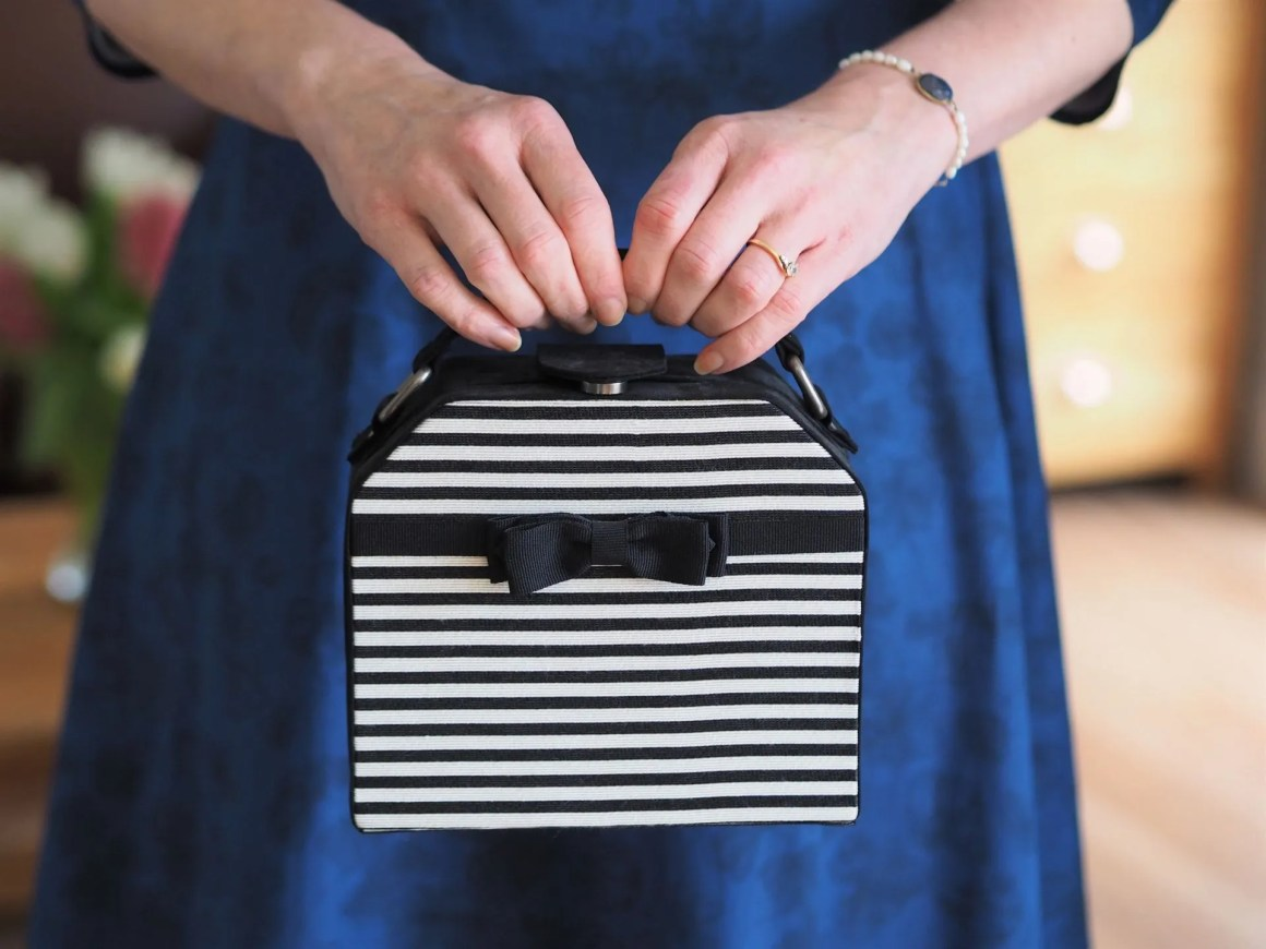 black and white striped boxy clutch bag with bow detail