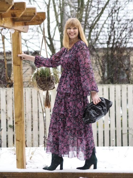 woman wearing dark floral tiered maxi dress