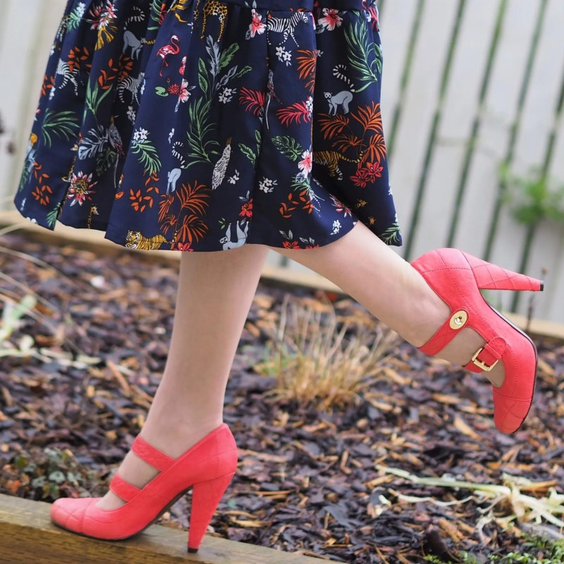 orange quilted high heeled shoes with two straps and postmans lock fastening