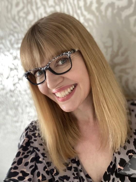 grey leopard print eyewear worn with grey leopard print dress