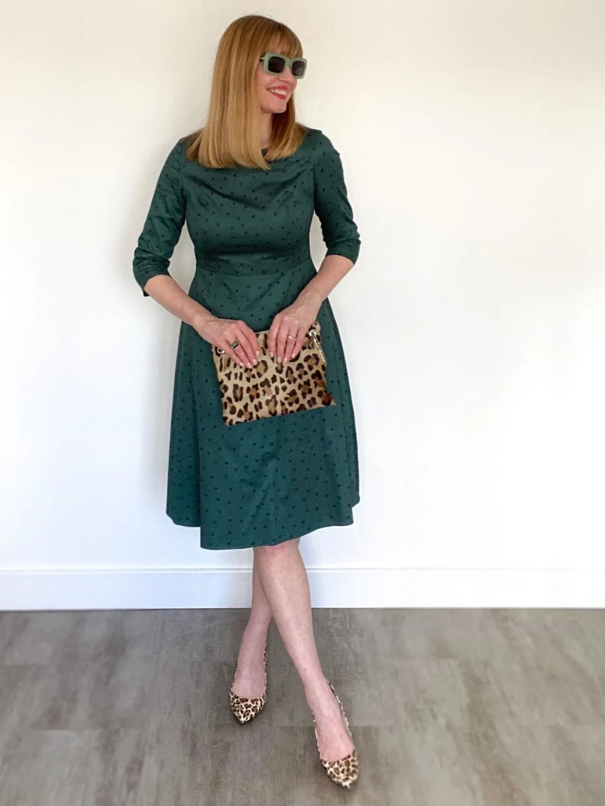 Green midcentury style dress with leopard print shoes