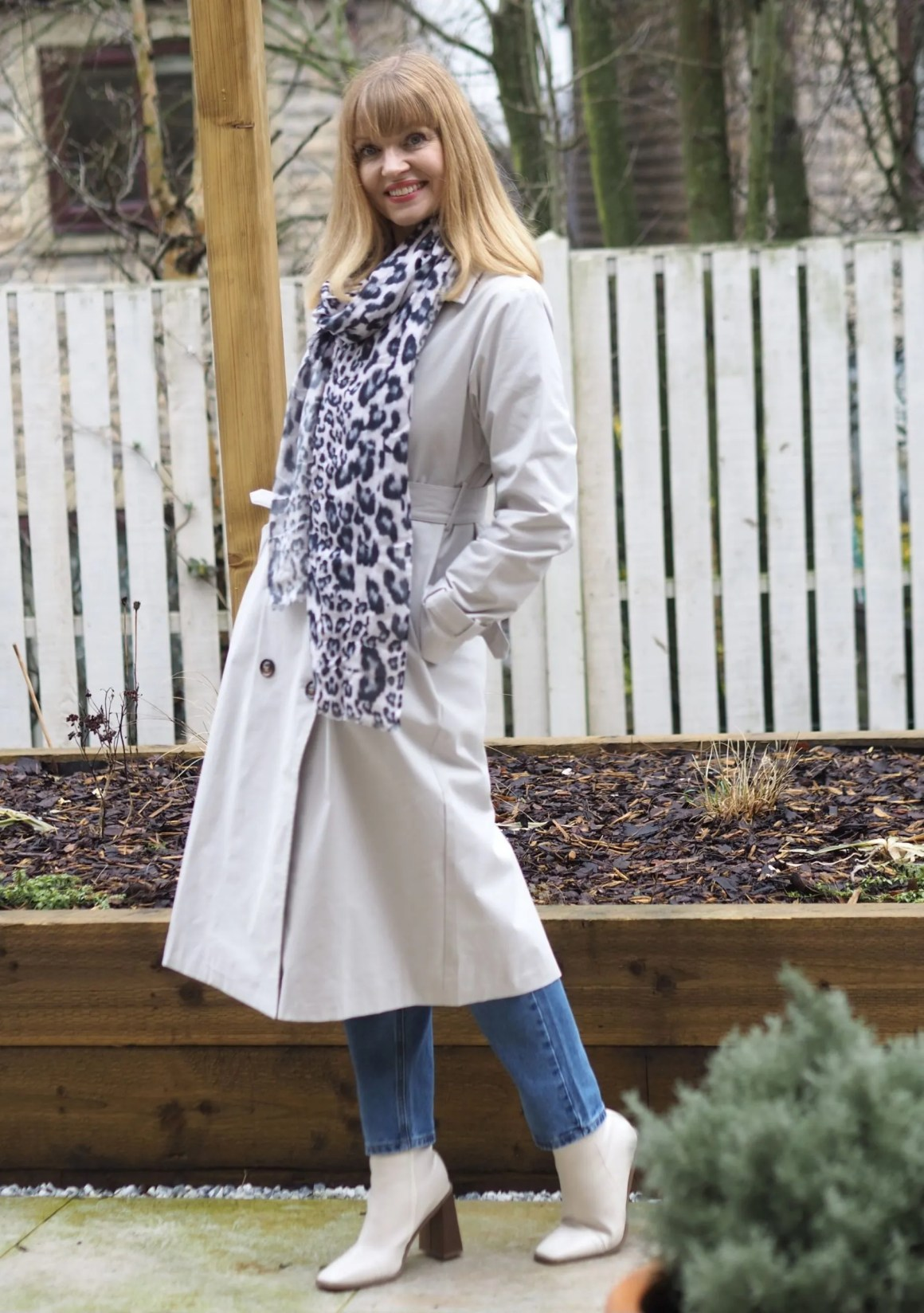 Trench coat and leopard [print scarf