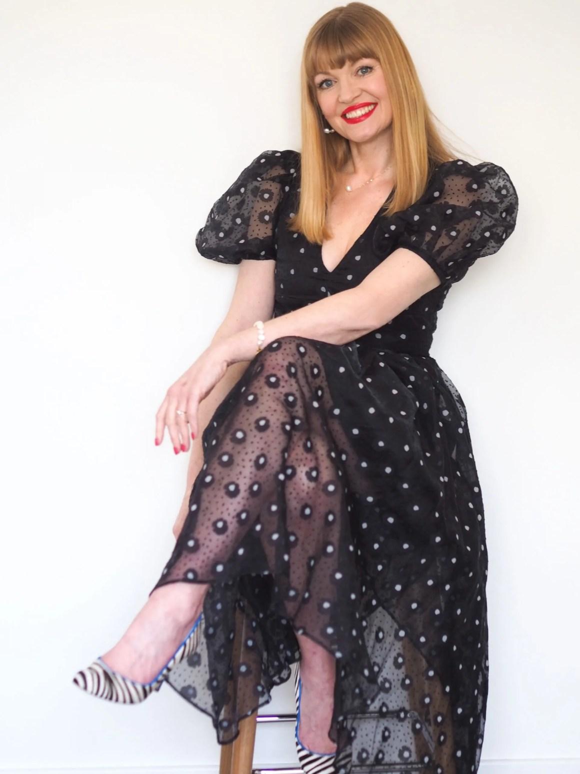Black puff sleeve dress with zebra print shoes