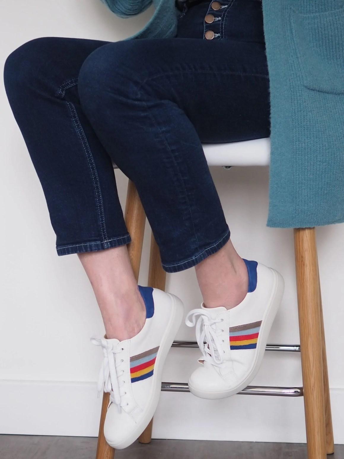 Elizabeth wears breton top, jeans and rainbow trainers