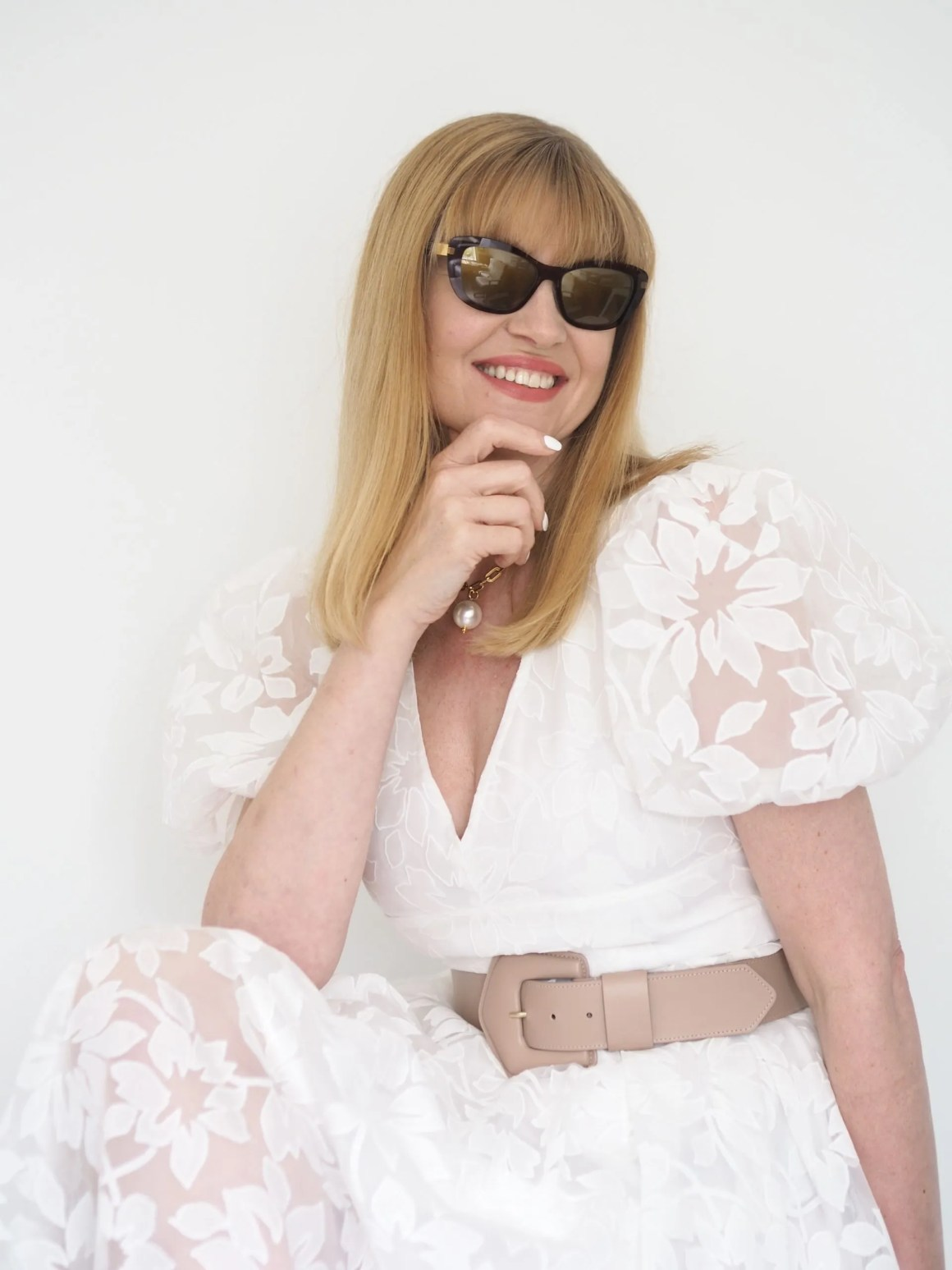 Woman in white dress wearing Mad in Italy sunglasses