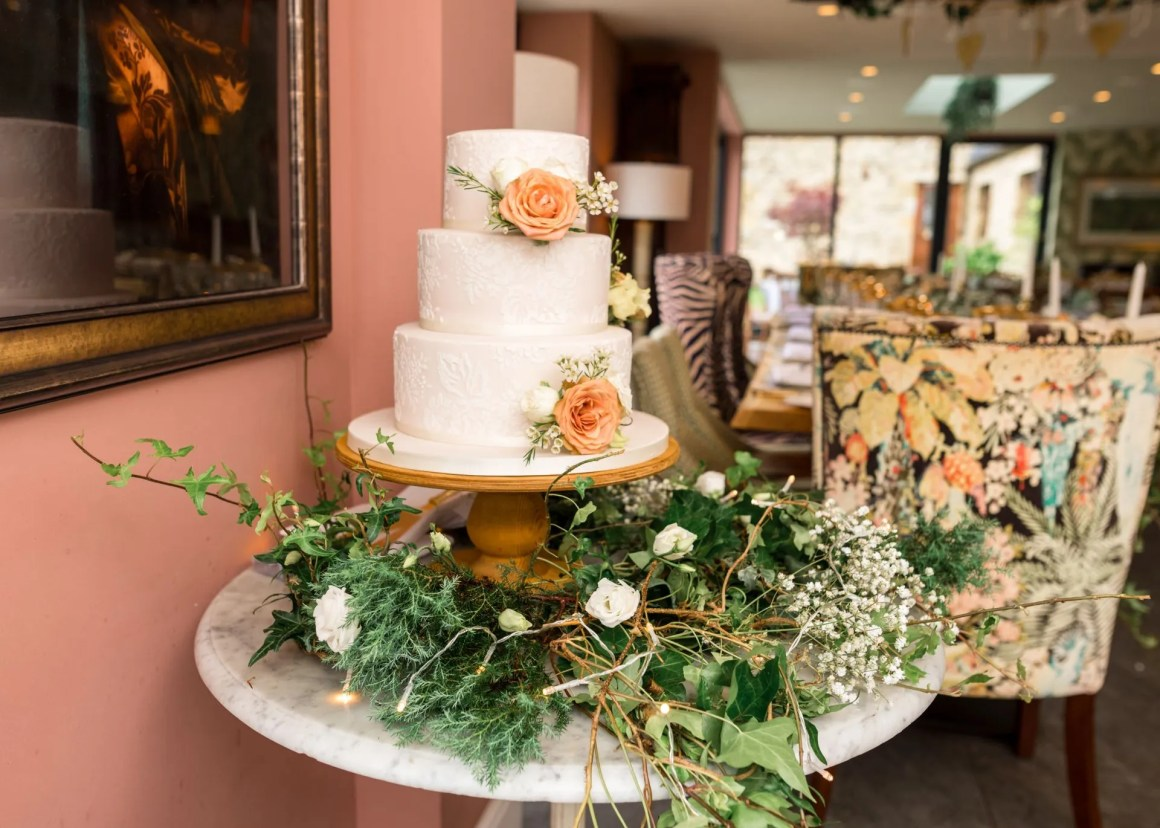 three tier wedding cake with nude icing and lace design