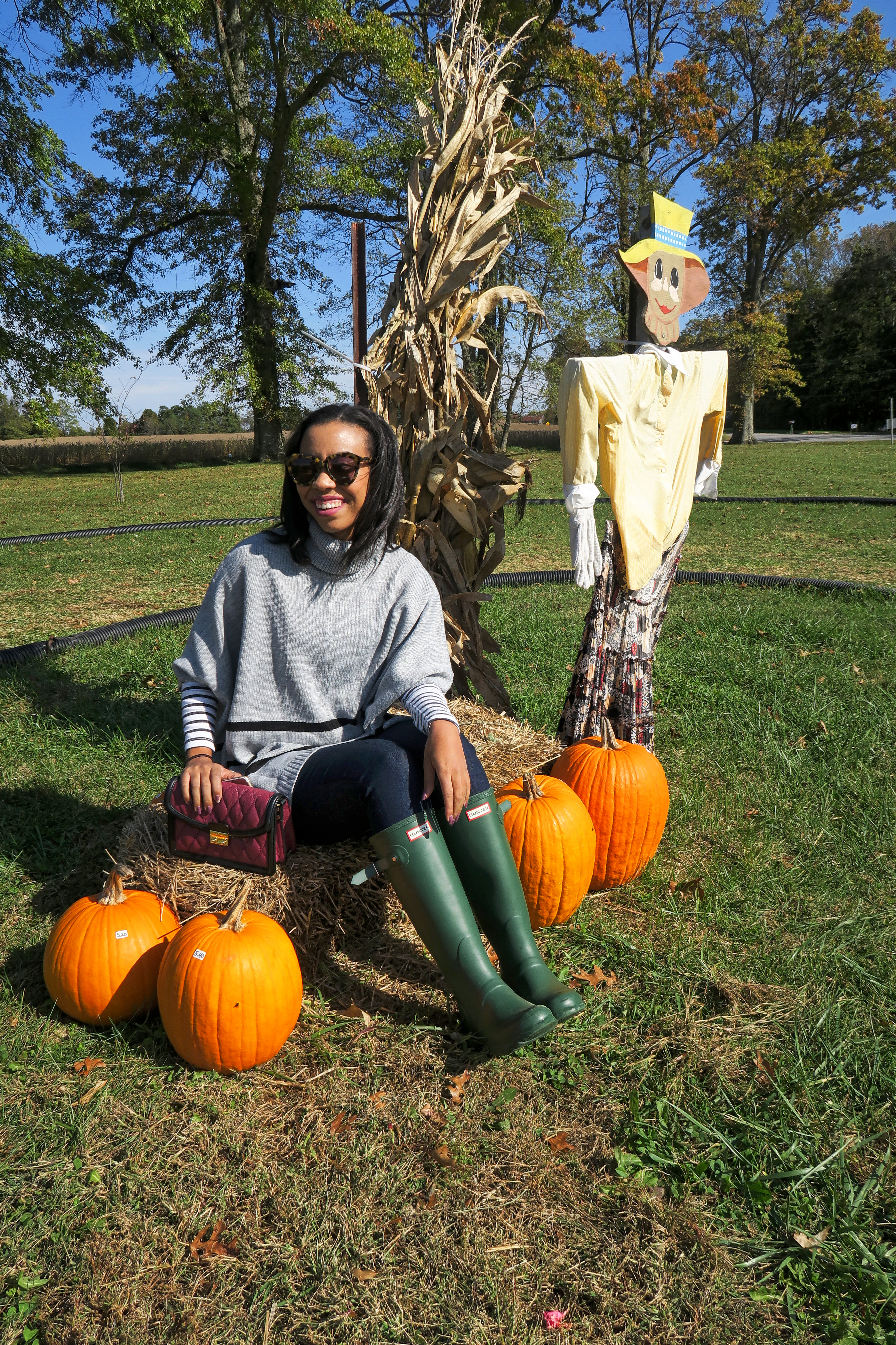 Affordable style blogger, What Nicole Wore, shares six of her favorite fall outfits and how to recreate them this fall with affordable fall fashion staples. // hunter boots outfit for fall, how to wear a poncho sweater, poncho outfit