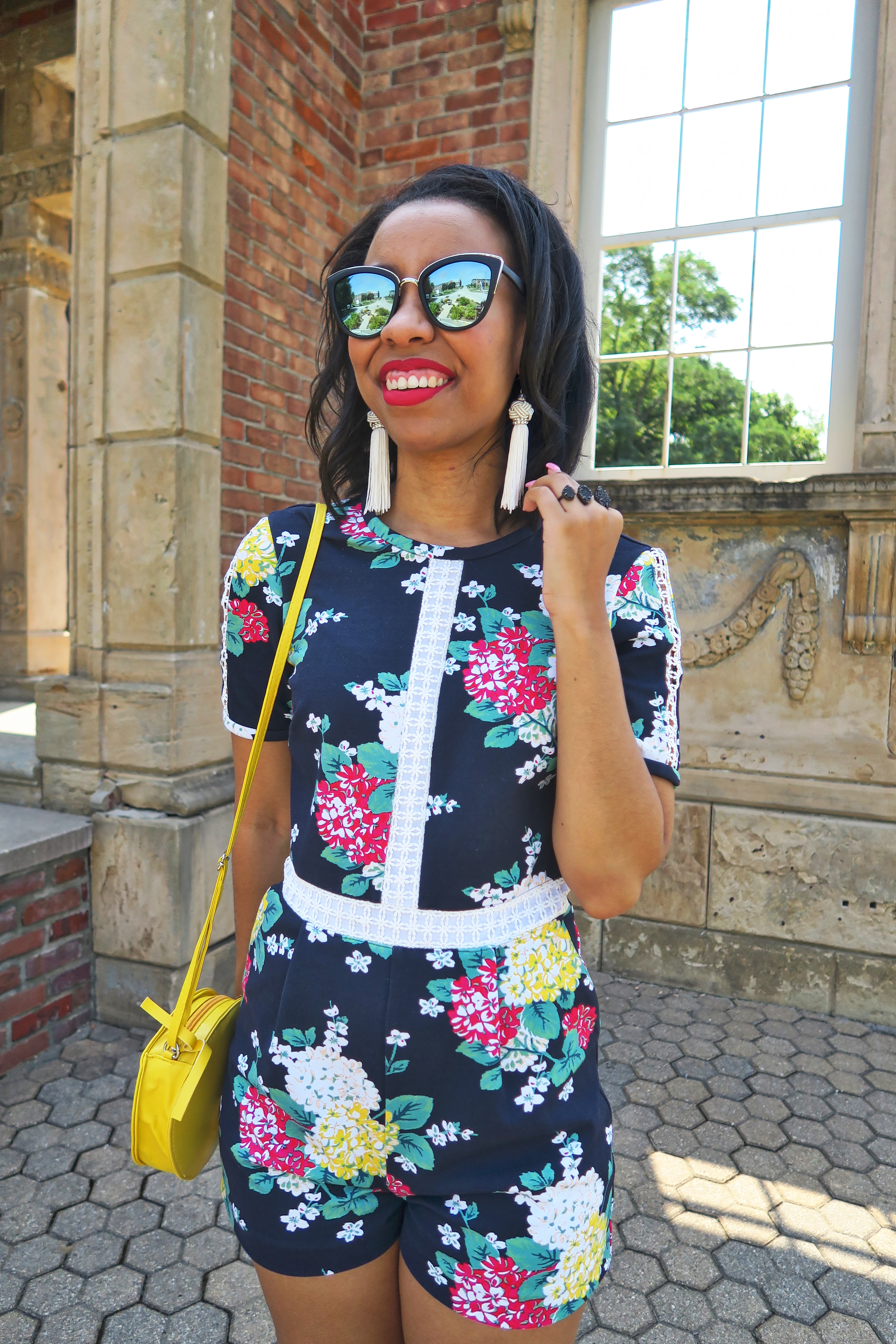 Southern fashion blogger, What Nicole Wore, styles mirrored cat eye sunglasses with a Draper James romper for an easy summer outfit. // affordable fashion, tassel earrings, kendra scott