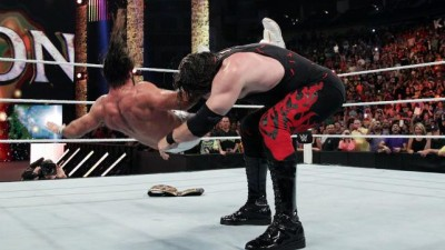 Kane sends Rollins for the ride