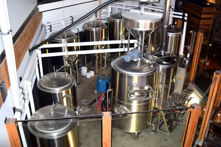 Glass-encased centrepiece brewhouse