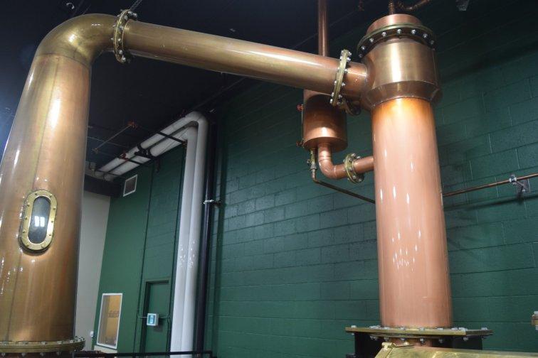 Dominating the expansive back area are the massive copper pot stills
