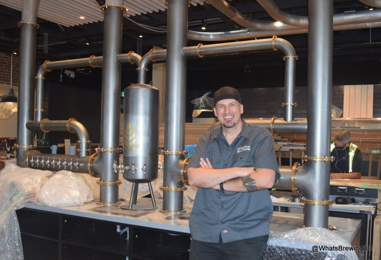 """The Barley Merchant Under Construction June 2021: Proprietor Tim LaHay with """"The Beast"""", a 50-tap craft beer, cider and wine tower"""
