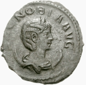 An ancient coin with the image of a woman's profile in Roman style