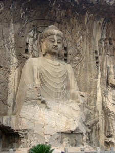 A tall Buddha described as looking like Wu Zetianstands in a grotto surrounded by smaller statues