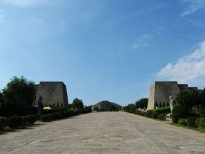 Two large tomb buildlings rise on either side of a large paved road, for Gaozong and Wu Zhao / Wu Zetian