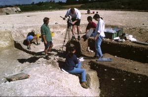 Archaeologists excavating and photographing the excavation site on Martin Green's farm where Cranborne Woman and three child skeletons were discovered.