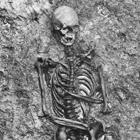 A skeleton partially unearthed from a archaeological dig shows a fully intact skeletal structure. This is Coppergate Woman, once thought to be Gunnhild.