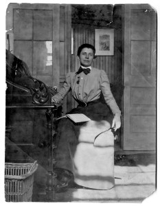 Ida Tarbell seated at a desk