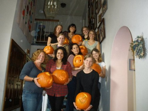 Some of my classmates at a pumpkin carving birthday party