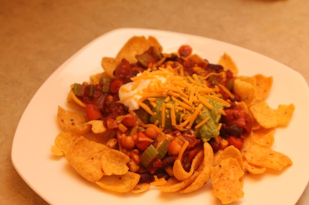 "What the Seventh Day Adventists call ""haystacks."" A bed of Fritos with vegetarian chili and all the fixins'! If there's one thing I learned from going to a Seventh Day Adventist institution, it is that haystacks are pretty delicious!"