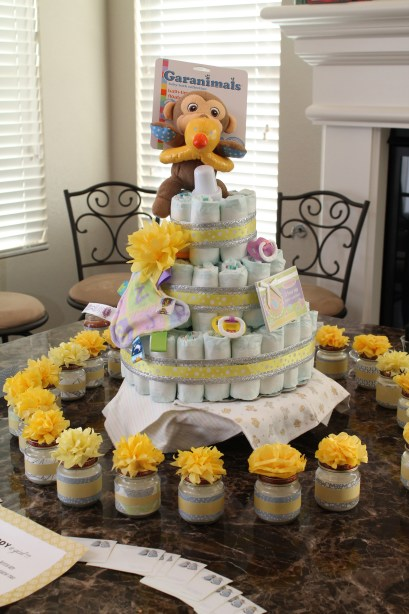 The day-of baby shower set-up. Cute, right?? To learn how to make a diaper cake, click here!