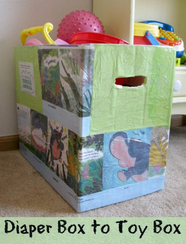What a fun easy craft to reuse empty diaper boxes! It's such a cute toy bin!