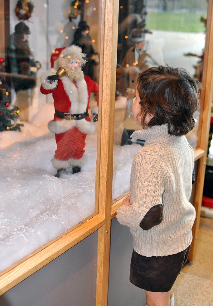 Boy looking into Ayers Window at Santa #ISMCelebration