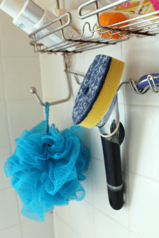 Hang-a-brush-with-dish-soap-and-vinegar-in-the-shower-for-easy-cleaning - practically functional