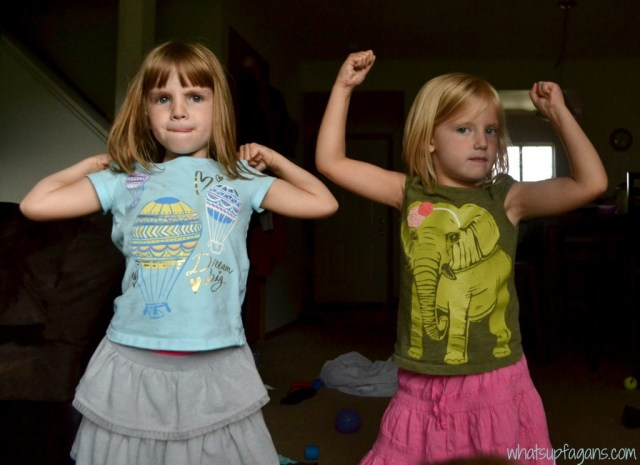 Twins flexing muscles