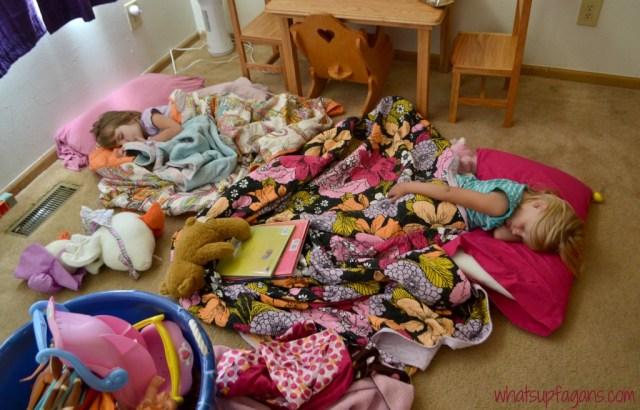 Twins sleeping on the floor