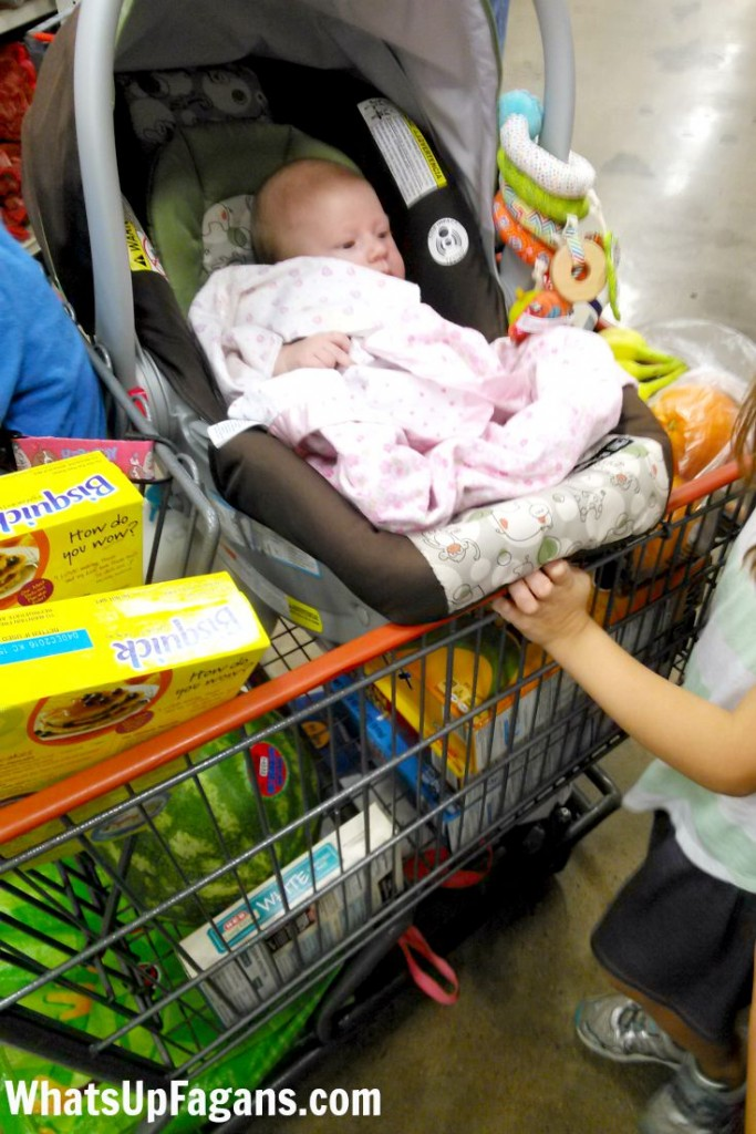 Putting a car seat on the shopping cart at the grocery store means a great game of Tetris...