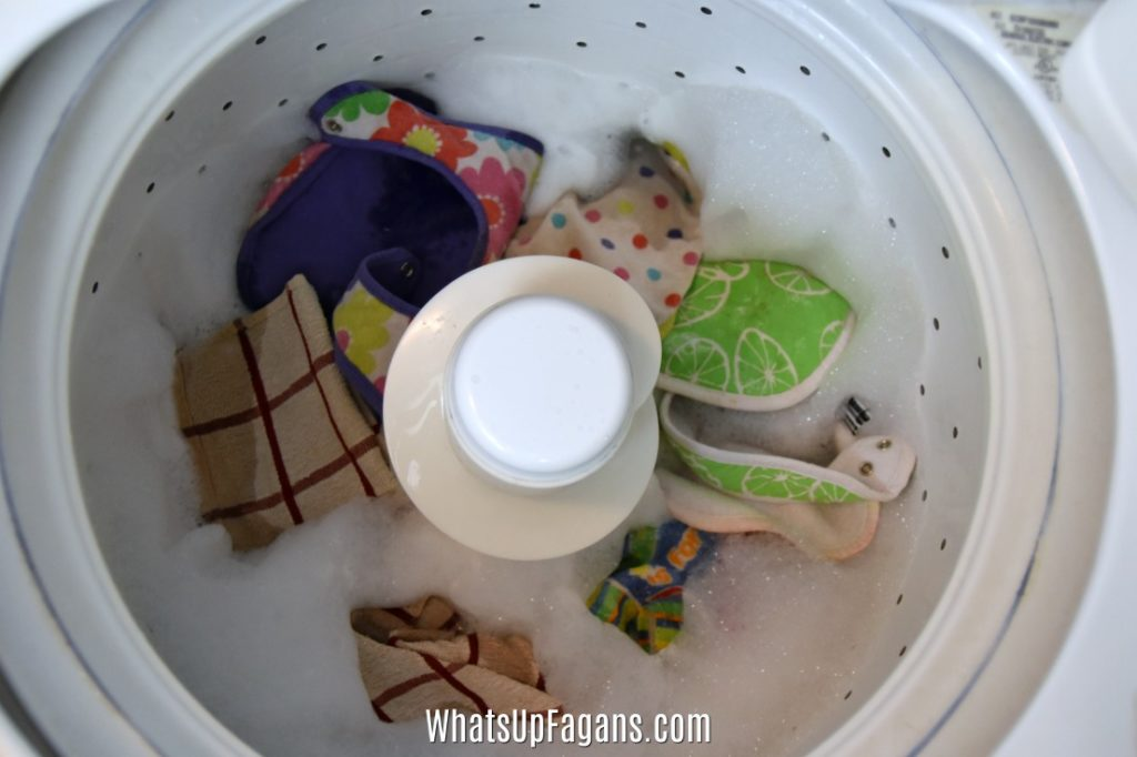 remove smells from dish towels and bibs