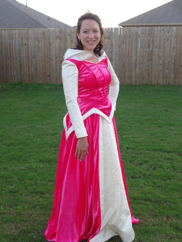 woman in sleeping beauty costume - borrowing maternity clothes