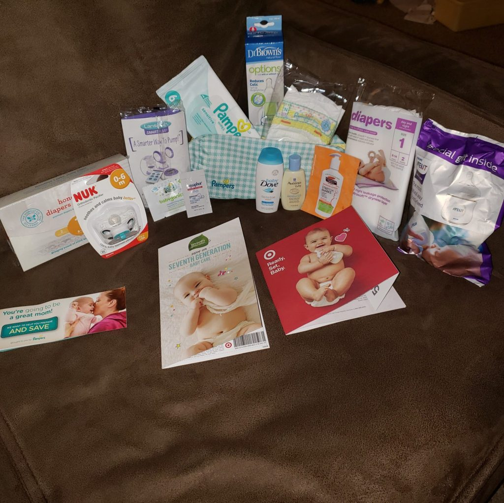 Target Baby Registry free samples lying on a couch, including several free breastfeeding samples