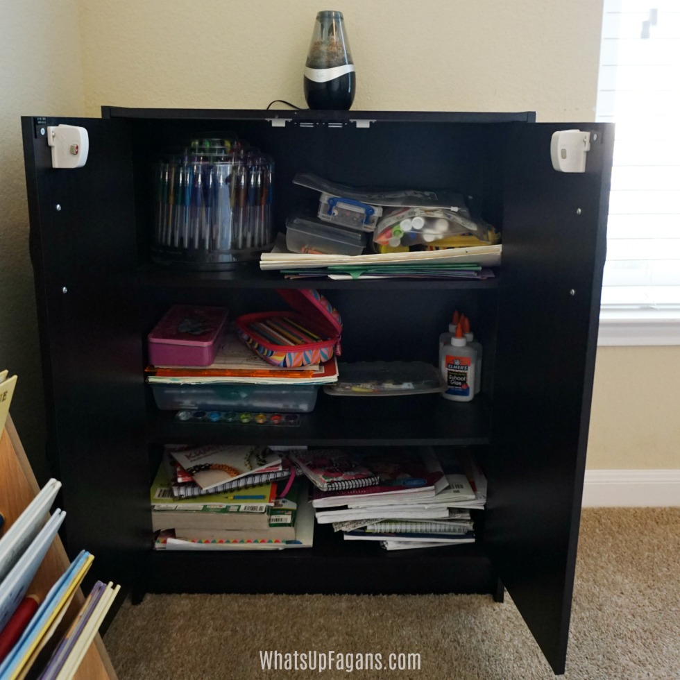 open arts and crafts cabinet to help people in organizing homeschool room