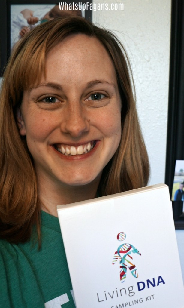 living dna test box in hands of young woman who wants living dna results